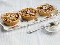 Individual apple tarts arranged on tray