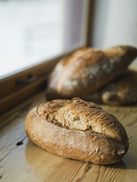 Loaves of bread on wooden counter