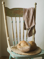 Bread loaves on wooden chair