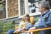 Couple relaxing with a glass of wine outdoors