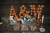 Wedding decorations surrounding bottled beverages on ice