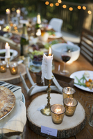Candles and food on wedding reception dining table