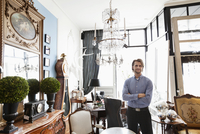 Portrait of male business owner standing in furniture store