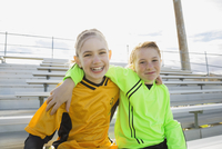Portrait of girls in soccer uniforms on bleachers