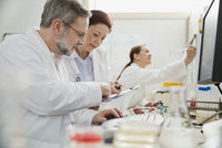 Male and female medical professionals working in lab