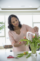 Pregnant woman arranging flowers