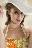 Portrait of pin-up girl in sunhat