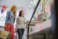 Young women shopping together at card store
