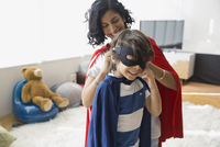 Mother with son in superhero costume