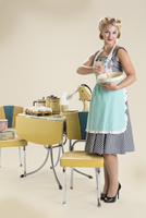 Housewife pin-up holding mixing bowl