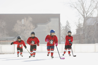 Ice hockey team skating on outdoor rink