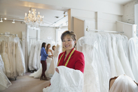 Portrait of small business owner working in bridal store