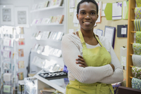 Portrait of female small business owner in card store