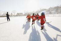 Ice hockey team skating on outdoor rink