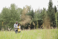 Romantic couple embracing in field