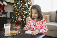 Girl writing letter to Santa Claus