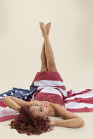 Pin-up girl covering herself with American flag