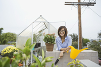 Woman standing outside of rooftop greenhouse