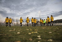 Soccer team walking on field
