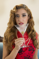 Rich housewife pin-up sipping a martini
