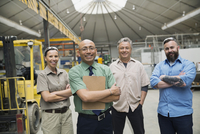 Confident workers in manufacturing plant