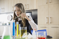 School girl conducting experiment in science classroom