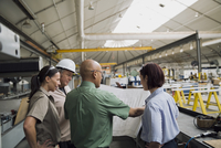 Workers reviewing blueprints in manufacturing plant 11096038507| 写真素材・ストックフォト・画像・イラスト素材|アマナイメージズ