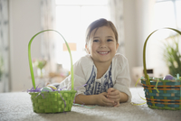 Portrait of cute girl with Easter baskets at home