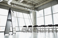 Interior of empty presentation room with chairs and white board
