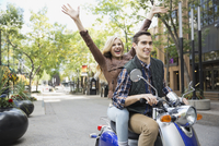 Cheerful couple enjoying scooter ride