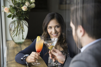 Couple enjoying cocktails at bar