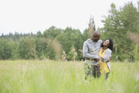 Woman embracing husband outdoors