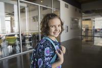 Portrait of confident school girl in corridor
