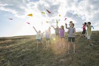 Children throwing paper aeroplanes during field trip