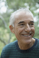 Close up portrait smiling mature man looking away