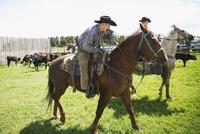 Cattle ranchers on horseback
