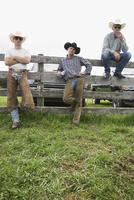 Portrait confident cattle ranchers at fence