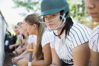 Portrait confident middle school girl softball player wearing batting helmet