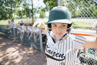 Focused middle school girl softball player ready to bat