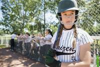 Focused middle school girl softball player preparing in batter