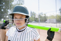 Portrait smiling middle school girl softball player ready to bat