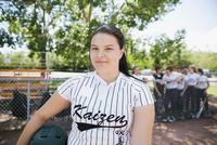 Portrait confident middle school girl softball player