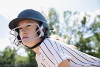 Serious middle school girl softball player wearing batting helmet