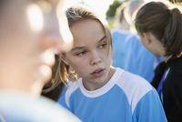 Middle school girl soccer player looking away