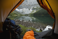 View of mountain and tranquil lake from inside of camping tent