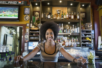 Portrait confident female bartender behind counter
