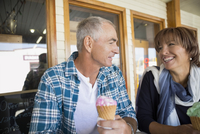 Mature couple eating ice cream cones