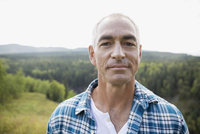 Portrait mature man on remote rural hill