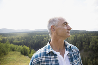 Mature man looking away on remote rural hillside