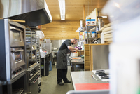 Chef cooking in restaurant commercial kitchen